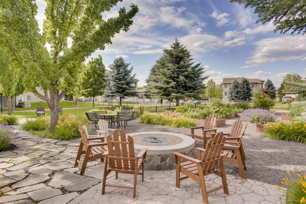 Fire pit surrounded by beautifully landscaped grounds at Big Trout Lodge in Liberty Lake, Washington