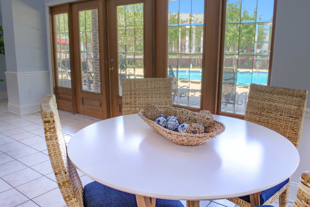 Table with a view of the pool at Oxford Point in Gulfport, Mississippi
