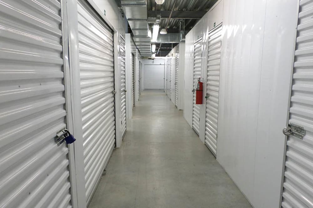 Hallway of climate controlled storage units at Compass Self Storage in Tavares, Florida
