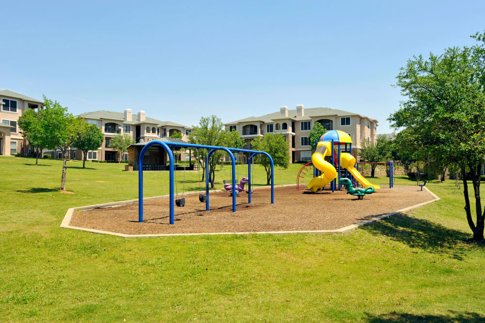 Spacious playground at Ballantyne Apartments in Lewisville, Texas