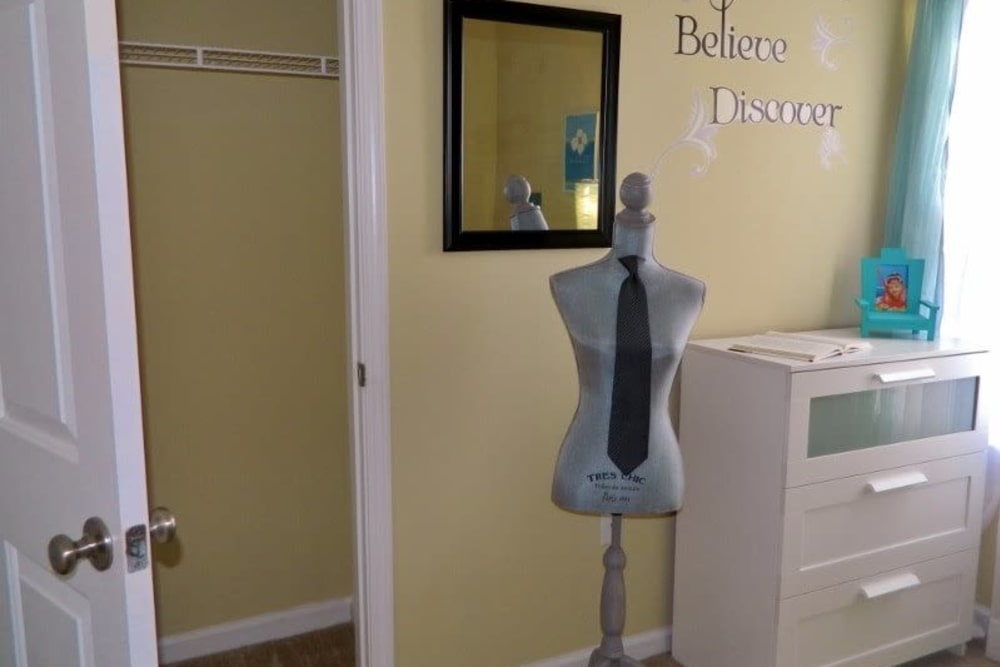 Model bedroom with a closet at Autumn View Apartments in Fayetteville, North Carolina