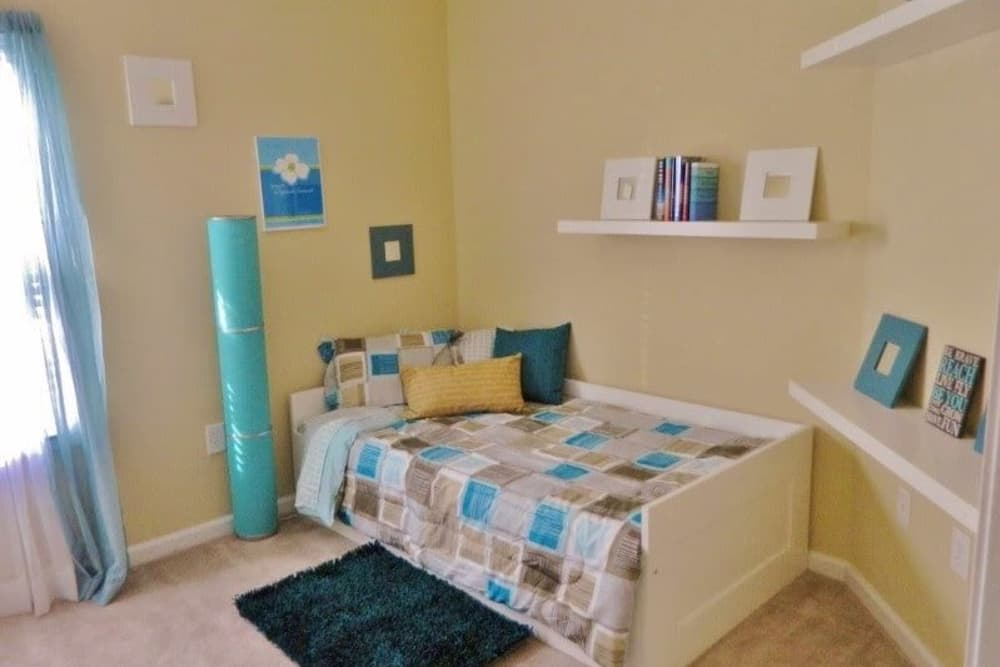 Well decorated bedroom at Autumn View Apartments in Fayetteville, North Carolina