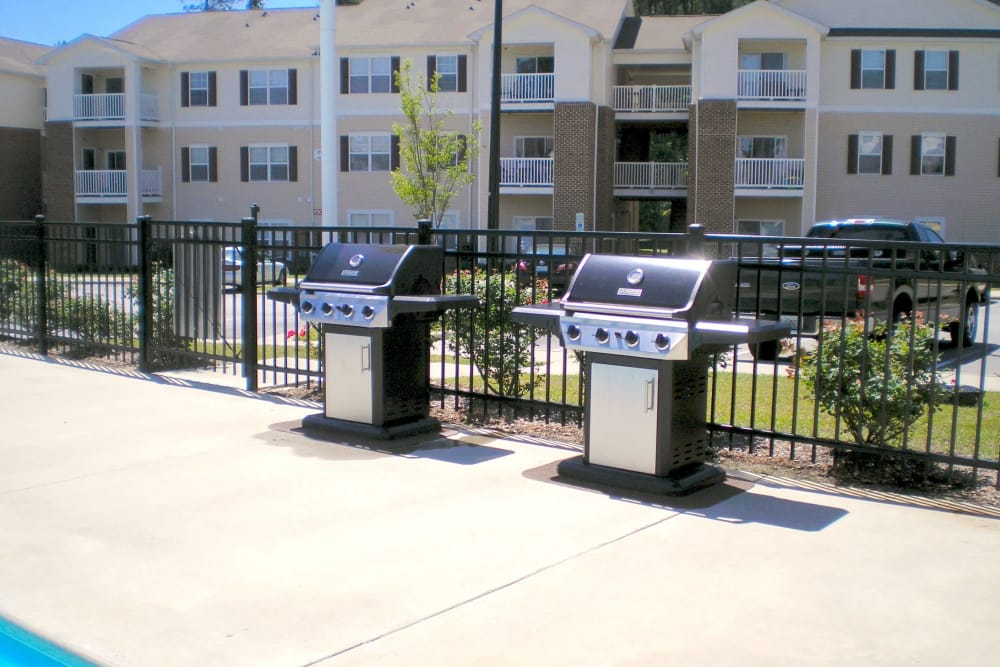 BBQ area near the pool at Autumn View Apartments in Fayetteville, North Carolina