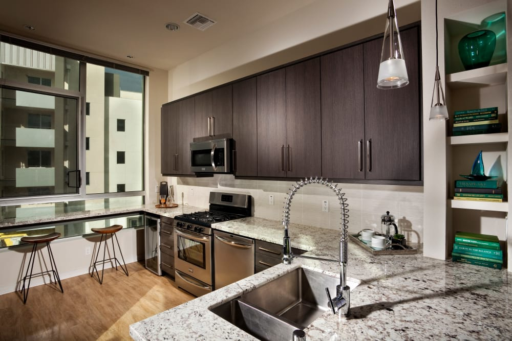 Model kitchen in apartments at Brio Apartment Homes in Glendale, California