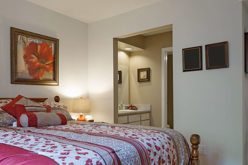Enjoy a cozy bedroom at Crescent Oaks in Graham, North Carolina
