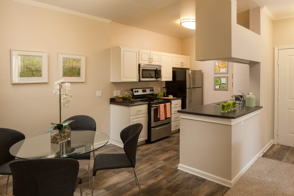 Model kitchen at Alize at Aliso Viejo Apartment Homes in Aliso Viejo, California