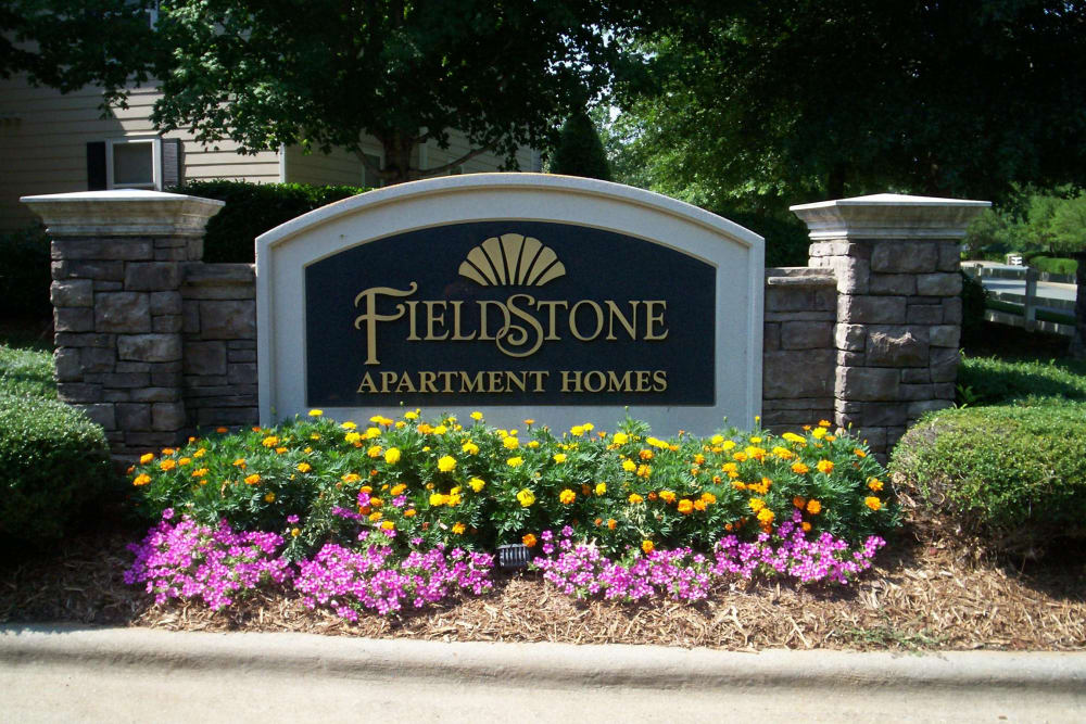 Monument sign at Fieldstone Apartments entry in Mebane, North Carolina