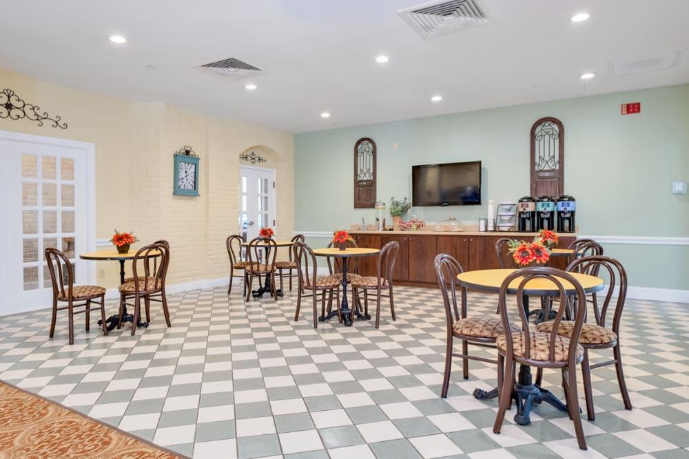 Dining area with TV at Grand Villa of Boynton Beach in Florida