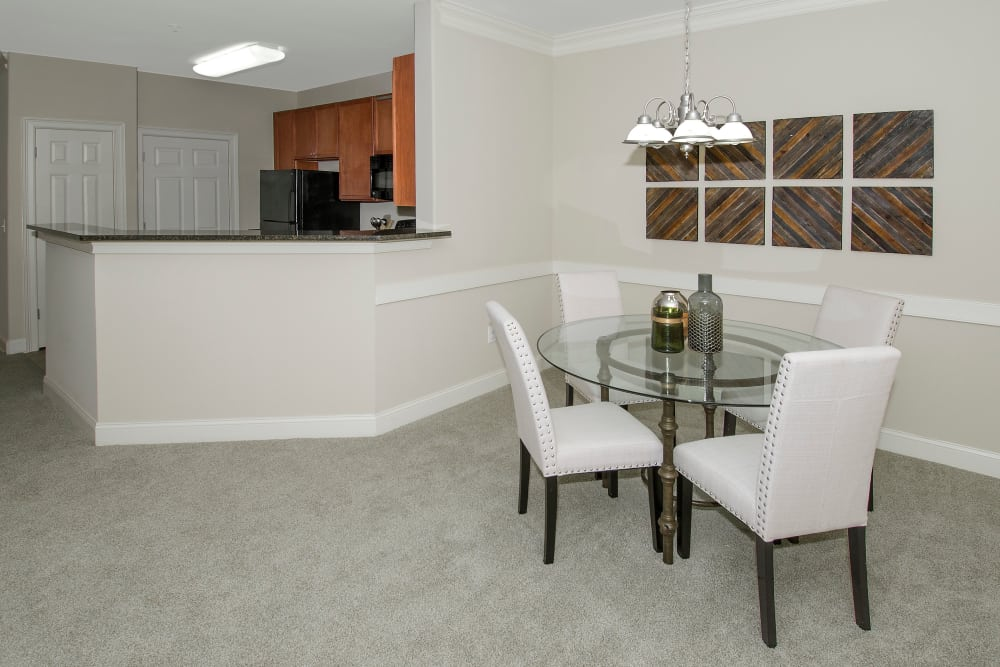Open kitchen and dining area at Apartments at the Venue in Valley, Alabama