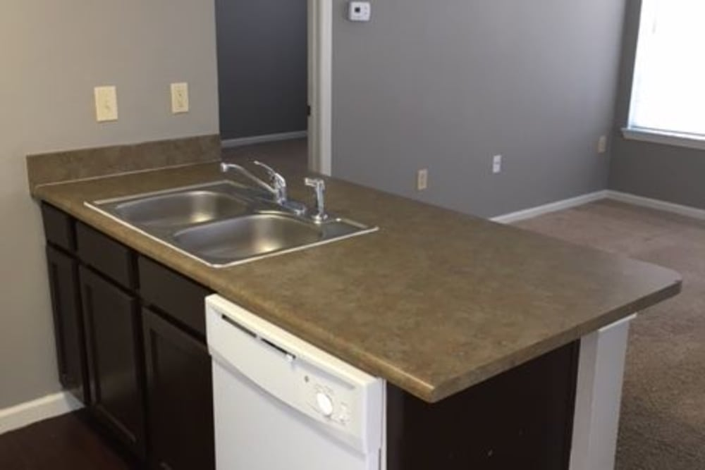 Kitchen and living area at Harbin Pointe Apartments in Bentonville, Arkansas