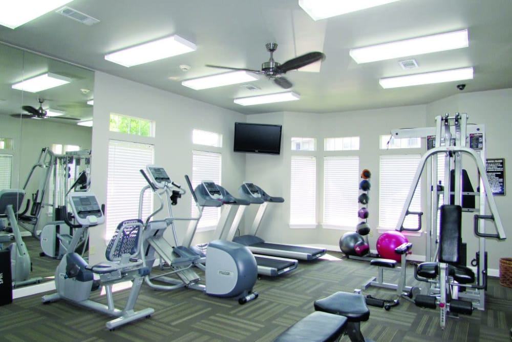 Fully equipped fitness center at Villas At Preston Lakes in Owasso, Oklahoma