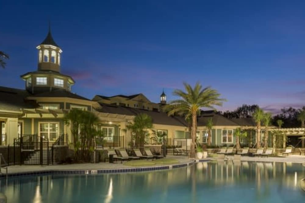 Swimming pool and clubhouse Integra 360 Apartment Homes in Winter Springs, FL