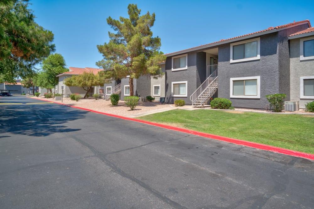 Walking path and apartments at Argenta Apartment Homes in Mesa, Arizona