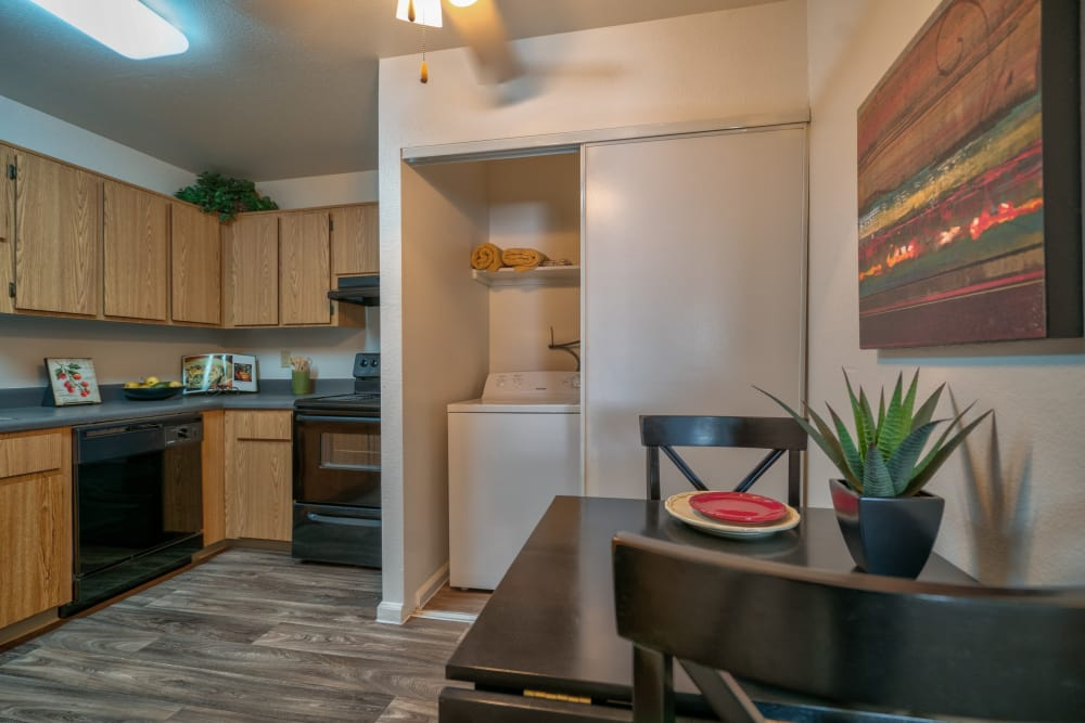 Dining area and  beautiful kitchen at Argenta Apartment Homes in Mesa, Arizona