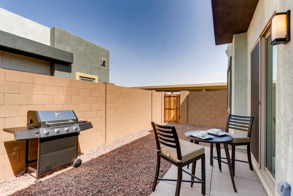Apartment backyard with barbecue area at Avilla Deer Valley in Phoenix, Arizona
