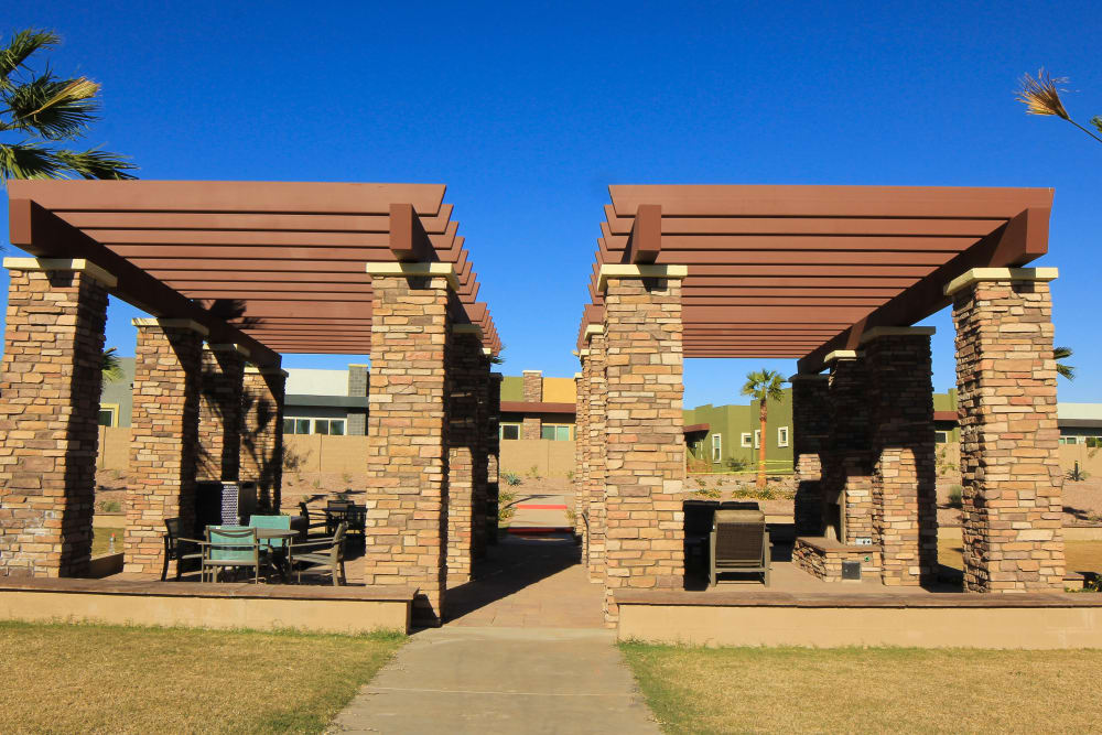 Outdoor seating under a pergola at Avilla Town Square in Gilbert, Arizona