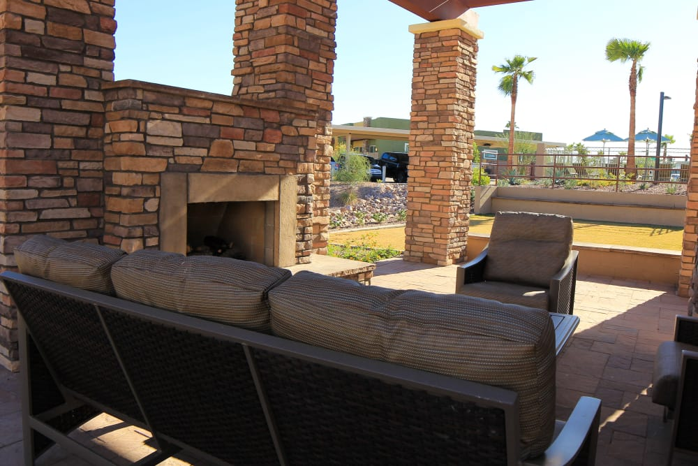 Outdoor seating and fireplace at Avilla Town Square in Gilbert, Arizona