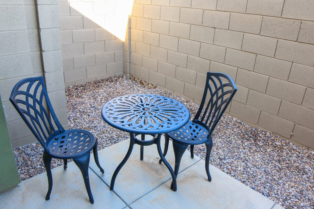 Private patio with table and chairs at Avilla Town Square in Gilbert, Arizona