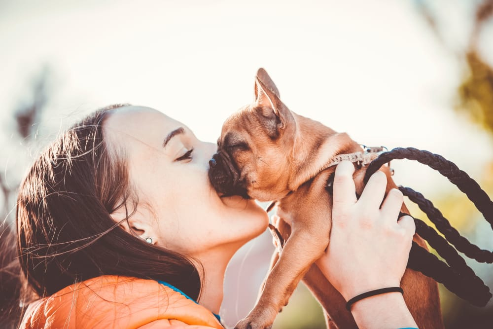Resident kissing her dog at The Barrett in Marietta, Georgia