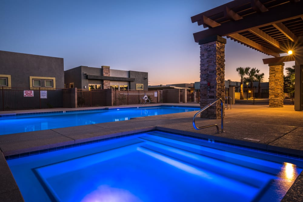 Well-lit pool at night at Avilla Grace in Chandler, Arizona