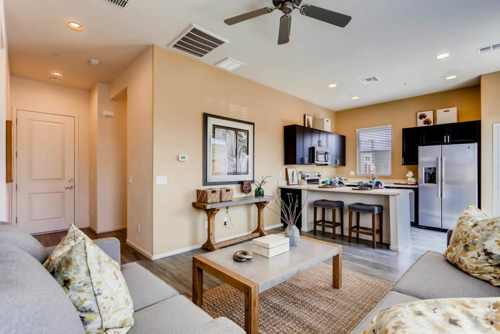 Spacious living room and kitchen at Avilla Lehi Crossing in Mesa, Arizona