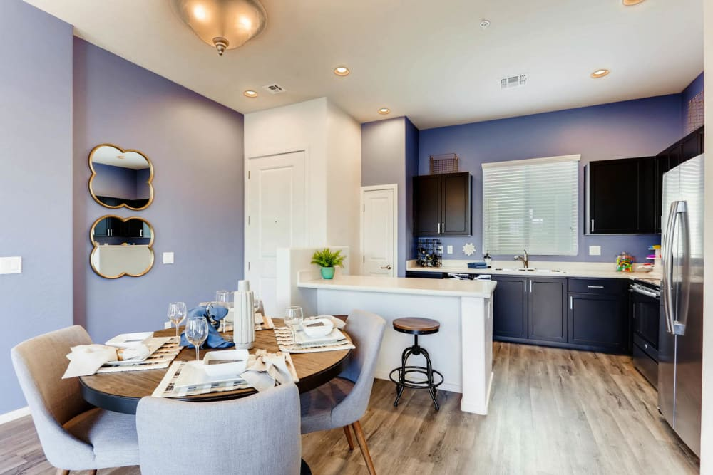 Dining area and kitchen at Avilla Lehi Crossing in Mesa, Arizona