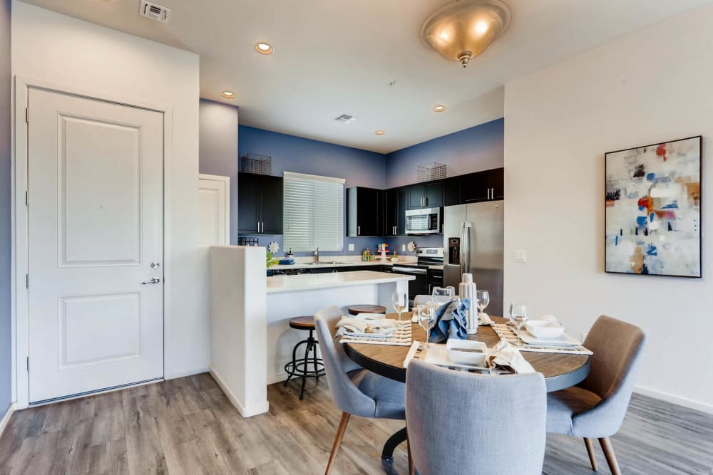 Dining room and kitchen at Avilla Centerra Crossings in Goodyear, Arizona