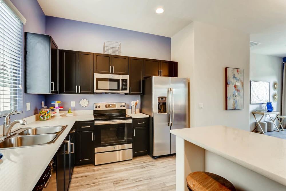 Model kitchen layout at Avilla Centerra Crossings in Goodyear, Arizona