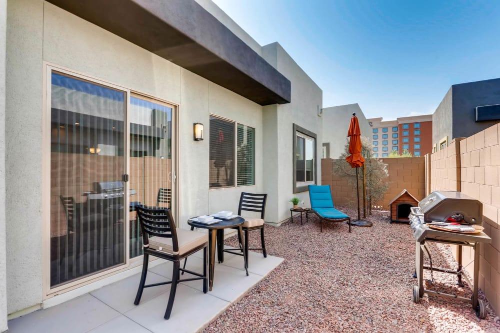 Sliding glass door to exterior patio in Goodyear, Arizona at Avilla Centerra Crossings