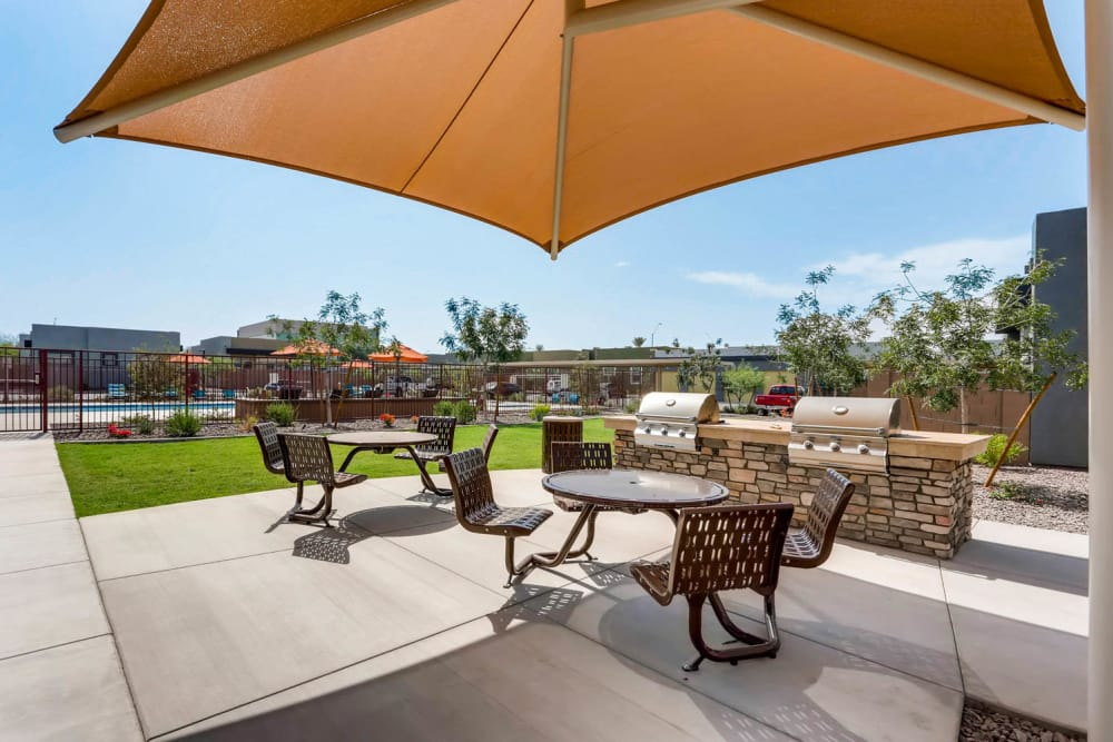 Outdoor patio seating and grilling area at Avilla Centerra Crossings in Goodyear, Arizona