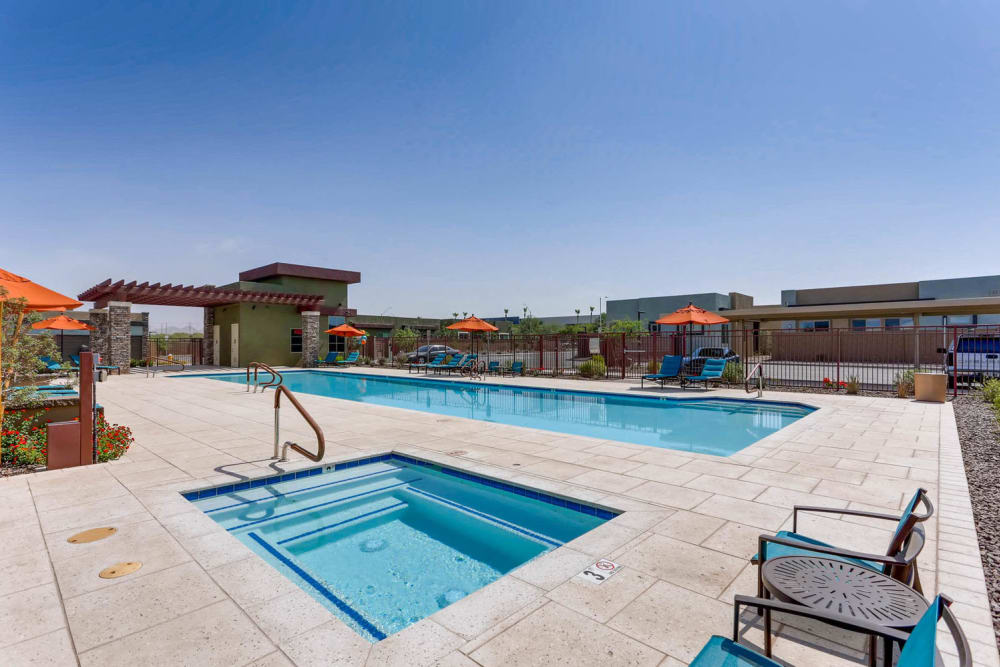 Swimming pool and hot tub on a sunny day at Avilla Centerra Crossings in Goodyear, Arizona