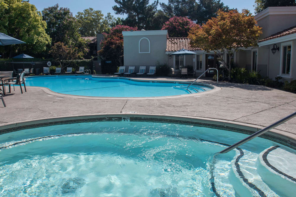 Hot tub next to the swimming pool at La Valencia Apartment Homes in Campbell, California