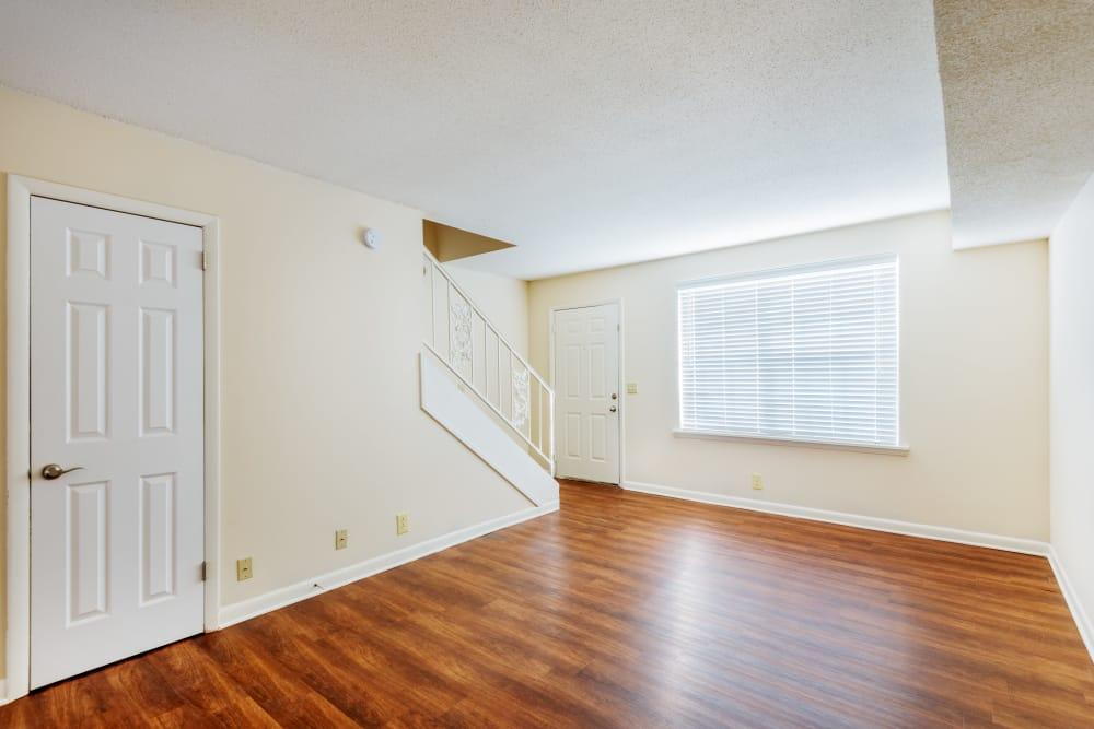 Living room with hardwood floors at Audubon Park in Nashville, Tennessee
