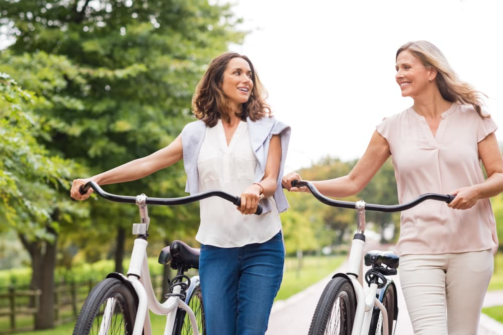 Residents going for a bike ride near Cooper Creek in Louisville, Kentucky