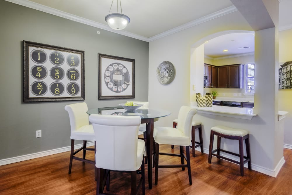 Dining area with hardwood floors in model home at Meritage at Steiner Ranch in Austin, Texas