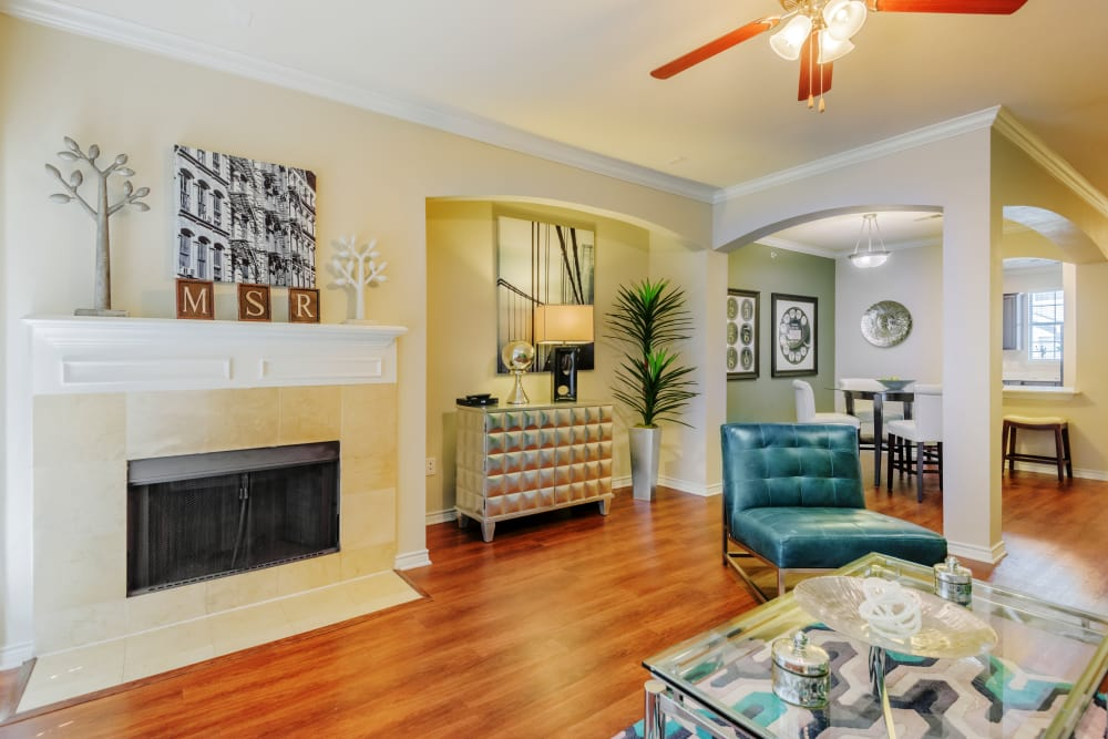 Open-concept living area with hardwood floors in model home at Meritage at Steiner Ranch in Austin, Texas