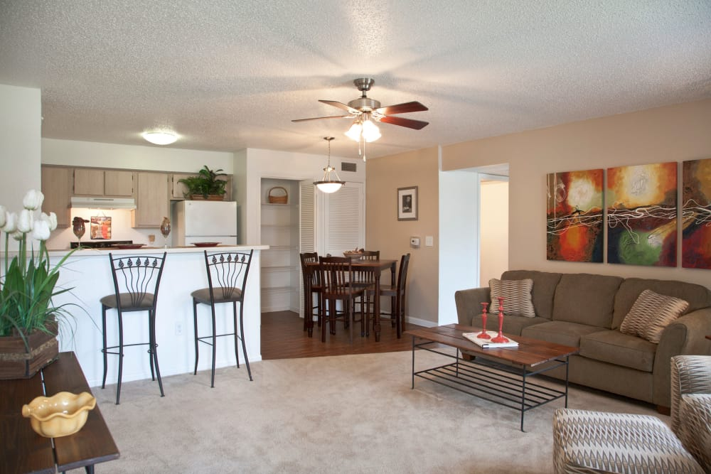 Open-concept living area with ceiling fan at Montelena in Round Rock, Texas