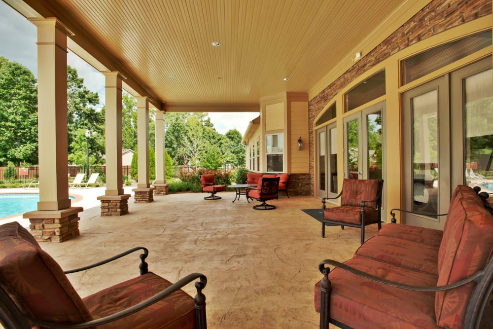 Covered outdoor patio near the pool at Richland Falls in Murfreesboro, Tennessee