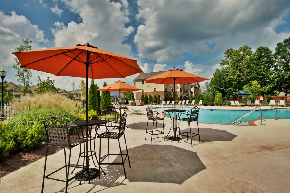 Well-maintained landscaping and covered seating near the pool at Richland Falls in Murfreesboro, Tennessee