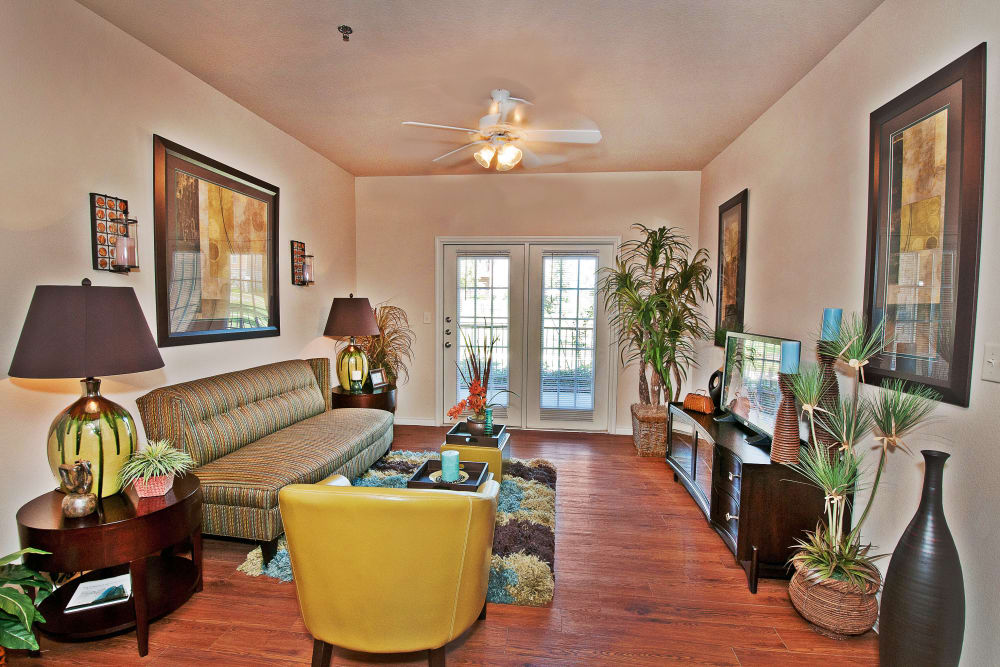 Open-concept living area with hardwood floors in model home at Trails at Buda Ranch in Buda, Texas