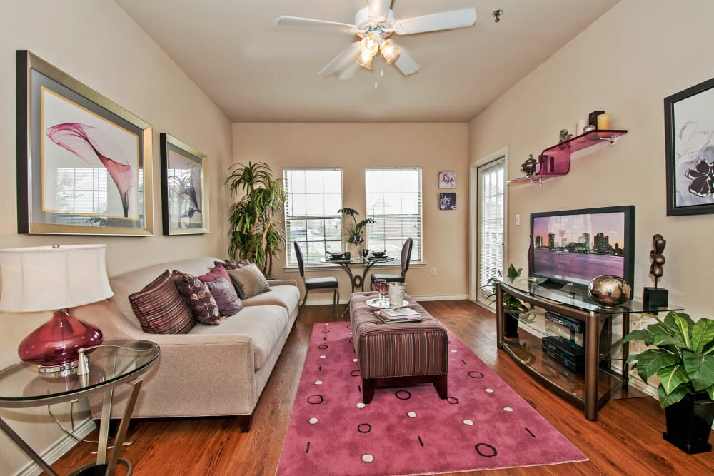Ceiling fan and modern decor in model home's living area at Trails at Buda Ranch in Buda, Texas