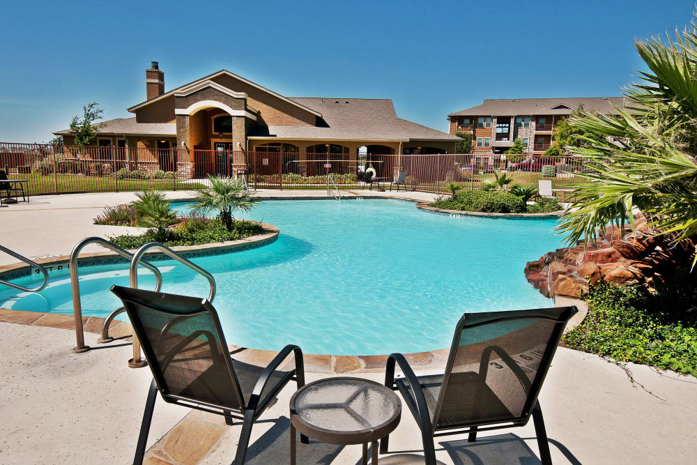 Gorgeous sparkling swimming pool and sundeck at Trails at Buda Ranch in Buda, Texas
