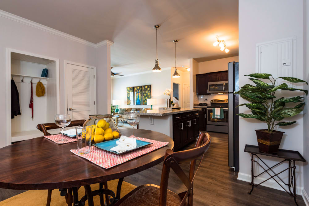 Open-concept floor plan with hardwood floors and custom lighting in model home at Valley Farms in Louisville, Kentucky