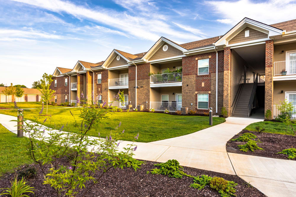Exterior view of resident building and well-maintained landscaping at Valley Farms in Louisville, Kentucky