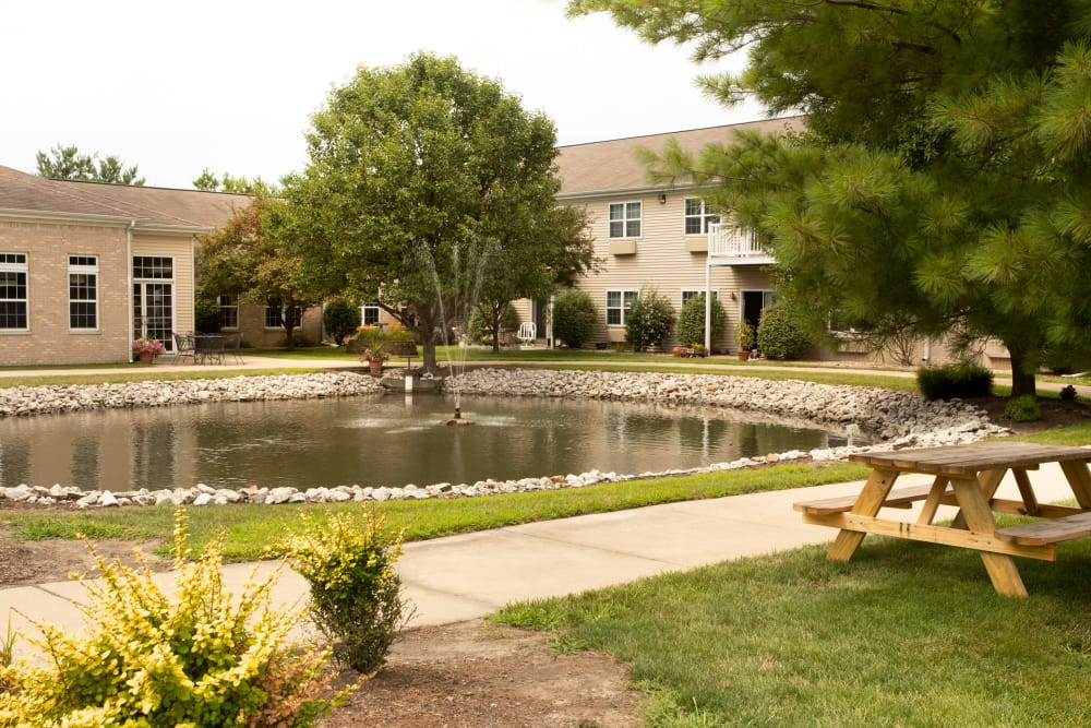 Outdoor picnic area with a pond at Randall Residence of Decatur in Decatur, Illinois