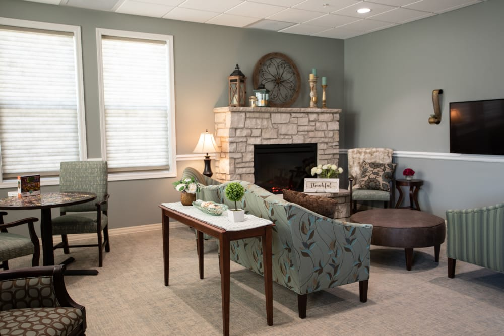 Well decorated model living room at Serenity, A Randall Residence in East Peoria, Illinois