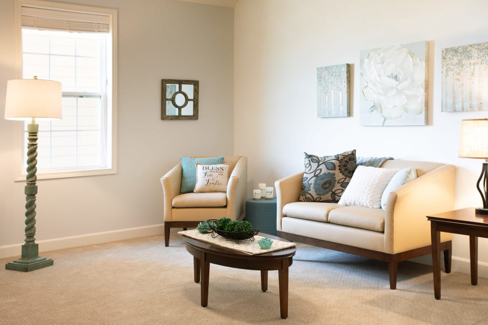 Carpeted living room at Serenity, A Randall Residence in East Peoria, Illinois