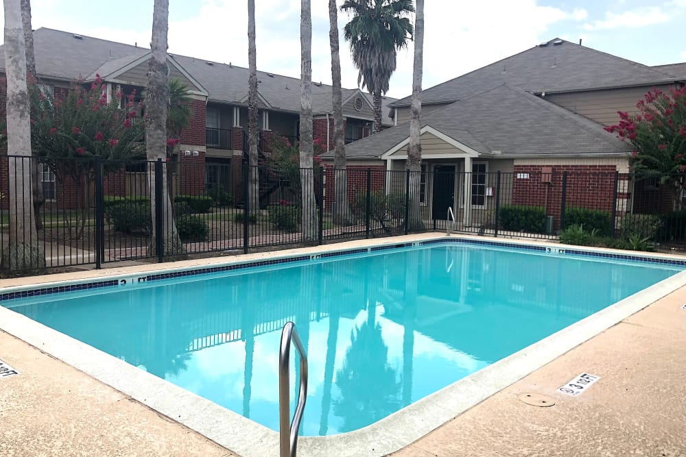 Westport Apartments offers a swimming pool in Angleton, Texas
