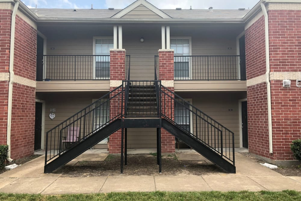Stairs leading up to apartments at Westport Apartments in Angleton, Texas