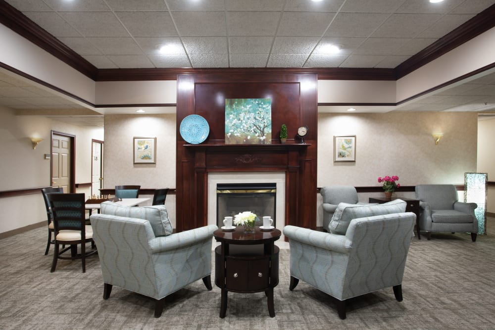Lounge with a fireplace at Governor's Pointe in Mentor, Ohio